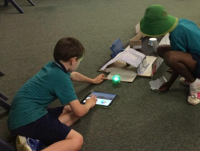 students using sphero on obstacle course