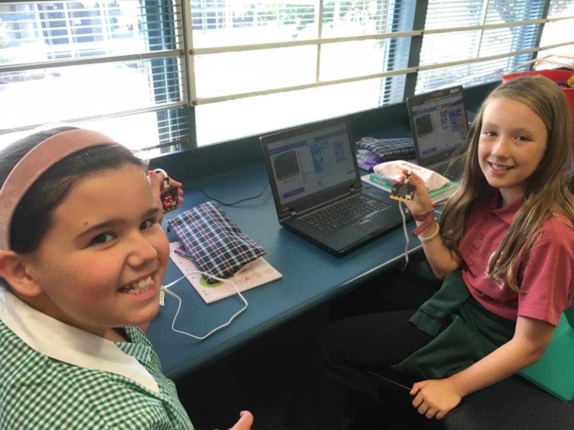 girls using micro:bits kits